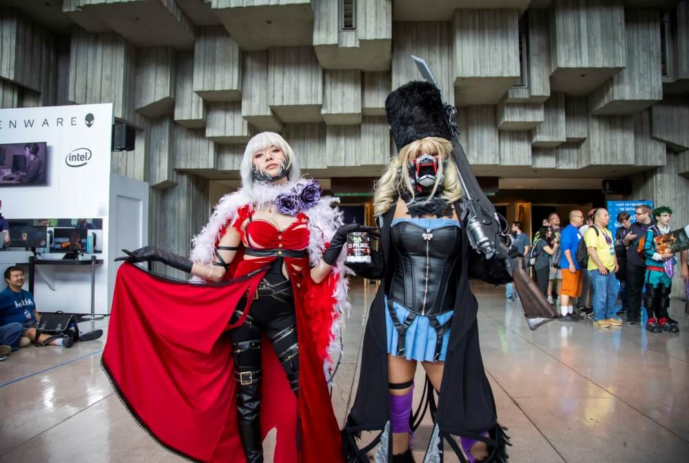 code vein eva and mia cosplays at pax west 2019 are holding a g fuel type-o tub