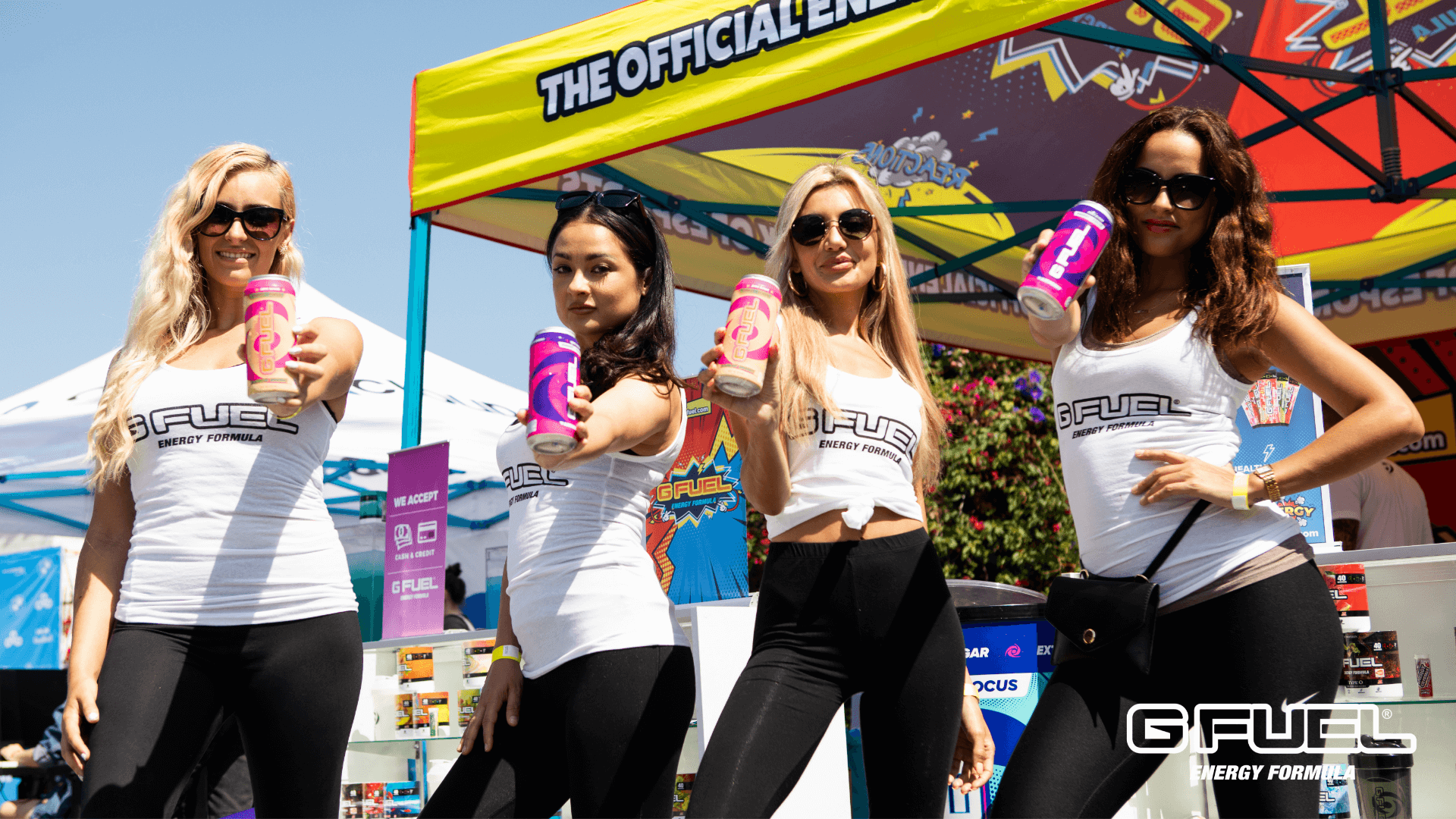 G FUEL girls holding Rainbow Sherbert and FaZeberry G FUEL cans at BLAST Pro Series Los Angeles 2019