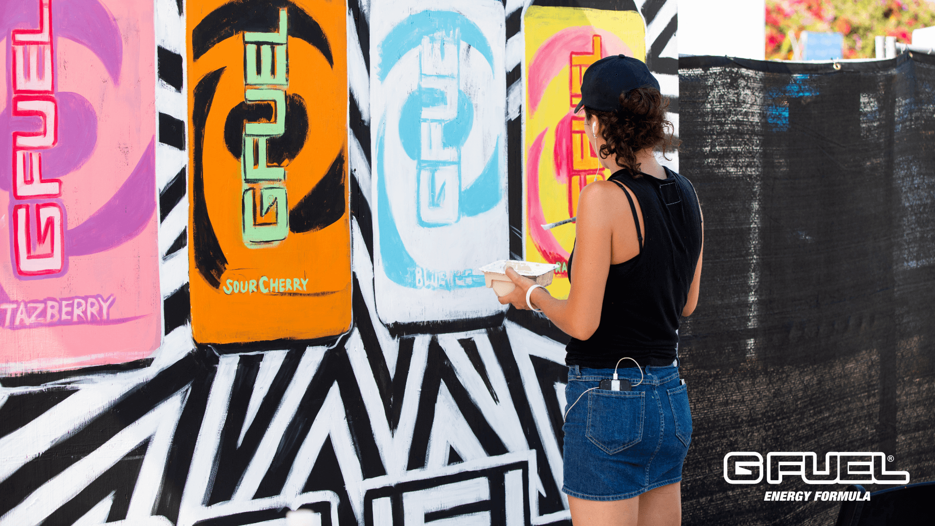 Artist Paulene Aguirre painting G FUEL cans at BLAST Pro Series Los Angeles 2019